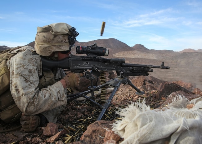 Pfc. Garrett Beck fires an M240B medium machine gun at distant targets during the company supported, live-fire assault portion of a Marine Corps Combat Readiness Evaluation at Marine Corps Air Ground Combat Center Twentynine Palms, Calif., Dec. 7, 2015 The purpose of a MCCRE is to evaluate Marines' collective performance in specific mission requirements that will prepare them for their upcoming deployment rotation. Beck is a machine gunner with Company F, 2nd Battalion, 7th Marine Regiment, 1st Marine Division. (U.S. Marine Corps photo by Lance Cpl. Devan K. Gowans)