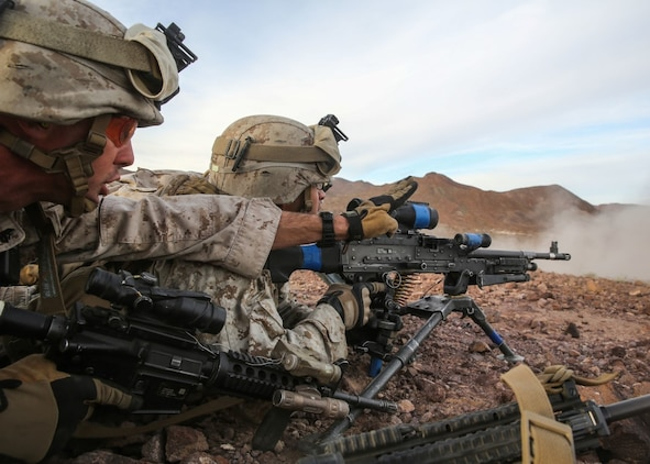 Cpl. Garrett Schroll gives instructions to a member of his team during the company supported, live-fire assault portion of a Marine Corps Combat Readiness Evaluation at Marine Corps Air Ground Combat Center Twentynine Palms, Calif., Dec. 6, 2015. The purpose of a MCCRE is to evaluate Marines' collective performance in specific mission requirements that will prepare them for their upcoming deployment rotation. Schroll is a machine gunner with Company W, 2nd Battalion, 7th Marine Regiment, 1st Marine Division. (U.S. Marine Corps photo by Lance Cpl. Devan K. Gowans)
