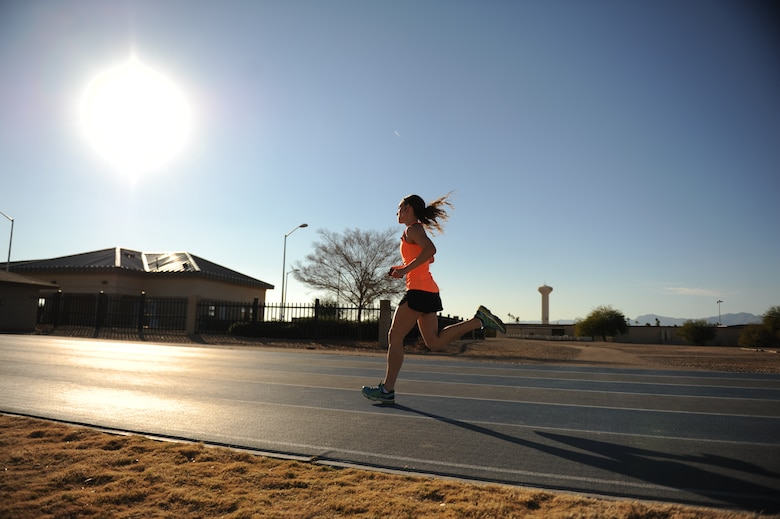 Senior Airman Melissa Franks, 56th Aerospace Medicine Squadron flight medicine medical technician, runs on the track at Luke Air Force Base, Ariz. Franks can run 1.5 miles in 9:15 and has placed first in all the 5-kilometer runs she's attended at Luke in the female category. (U.S. Air Force photo by Senior Airman Grace Lee)