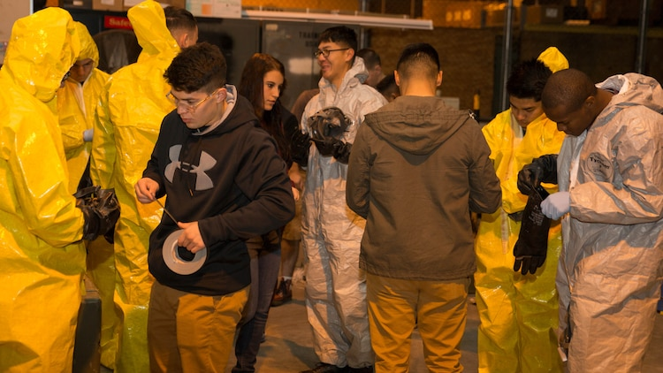 Marines from Marine Wing Support Squadron 171 dawn their personal protective equipment during Hazardous Waste Operations and Emergency Response training at Marine Corps Air Station Iwakuni, Japan, Dec. 18, 2015. Marines who have trained in HAZWOPER may translate their official certification into the civilian sector, giving this training more significance inside and outside the Corps. While it is mandatory for hazardous workers in the U.S. to undergo HAZWOPER training, it is not a requirement for all Marines.