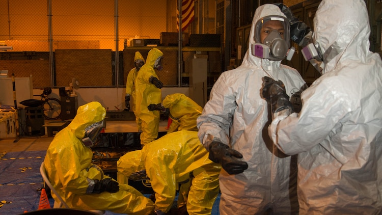 Marines from Marine Wing Support Squadron 171 proceed though a decontamination line during Hazardous Waste Operations and Emergency Response training at Marine Corps Air Station Iwakuni, Japan, Dec. 18, 2015. This course provides Marines with proper certification to handle any hazardous situation that may occur. Accurate training is instilled to ensure the Marines recognize and understand the importance of practice and its role in avoiding potential hazards.