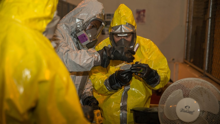Marines from Marine Wing Support Squadron 171 take chemical samples during Hazardous Waste Operations and Emergency Response training at Marine Corps Air Station Iwakuni, Japan, Dec. 18, 2015. The Marines attended a 40-hour course that taught them how to respond in the case of an emergency and how to operate safely around hazardous materials, waste, substances, and fuels. The Marines conducted classes indoors for three days before exercising practical application for the remainder of the course.