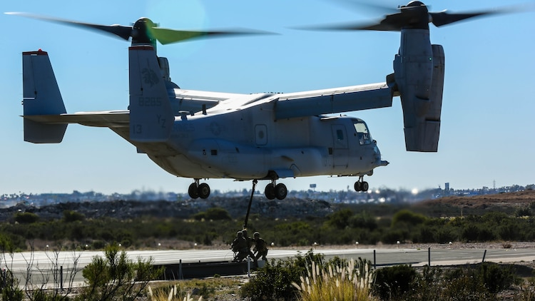 Marines with Combat Logistics Battalion 5 attach a simulated cargo of 1,400 pounds to an MV-22B Osprey with Marine Medium Tiltrotor Squadron 363 aboard Marine Corps Air Station Miramar, Calif., Dec. 16, 2015. Daytime external lift training prepares the Marines with VMM-363 to attach cargo to the aircraft which helps qualify more air crew in the mission-essential task of rapid insertion and extraction for the squadron.