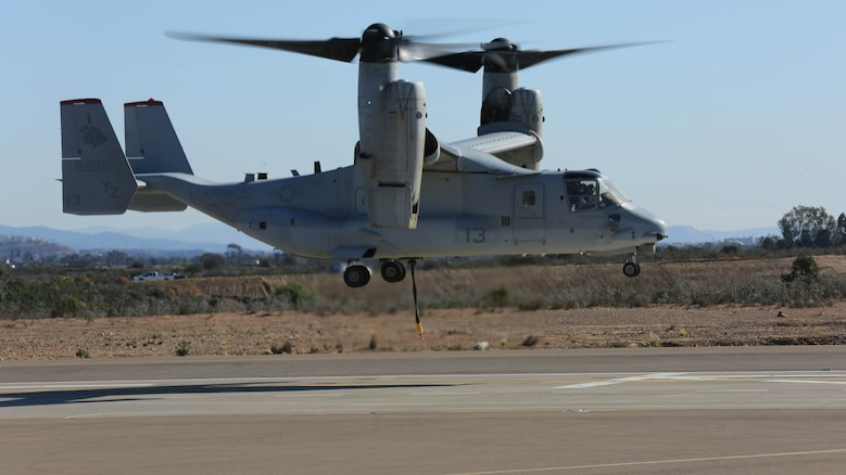 An MV-22B Osprey with Marine Medium Tiltrotor Squadron 363 takes off and begins daytime external lift training aboard Marine Corps Air Station Miramar, Calif., Dec. 16, 2015. Daytime external lift training prepares the Marines with VMM-363 to attach cargo to the aircraft which helps qualify more air crew in the mission-essential task of rapid insertion and extraction for the squadron.