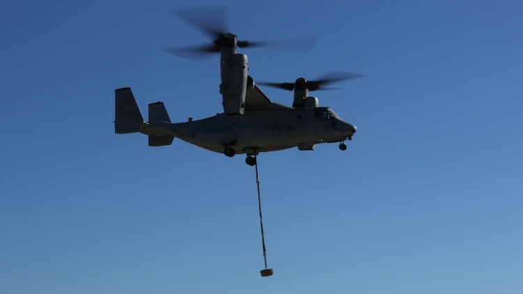 An MV-22B Osprey with Marine Medium Tiltrotor Squadron 363 carries a simulated cargo of 1,400 pounds aboard Marine Corps Air Station Miramar, Calif., Dec. 16, 2015. Daytime external lift training prepares the Marines with VMM-363 to attach cargo to the aircraft which helps qualify more air crew in the mission-essential task of rapid insertion and extraction for the squadron.