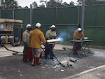 Plasma cutting is taught to Disposition Services Unit Six sailors in a safe and controlled environment.