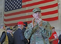 Maj. Gen. Wayne W. Grigsby Jr. 1st Infantry Division and Fort Riley commanding general, applauds veterans as they enter a hangar Nov. 6 at Marshall Army Airfield during the Vietnam Veterans Welcome Home Ceremony. The event provided a welcome-home experience the veterans never received when they returned from the Vietnam War.