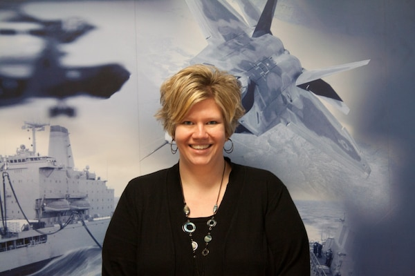 """Margaret """"Meg"""" Ross, supervisory contract specialist at Defense Logistics Agency Distribution headquarters' Acquisition Operations, has been awarded the Distribution Employee of the Quarter award for fourth quarter, fiscal year 2015, for her superior performance and teamwork."""