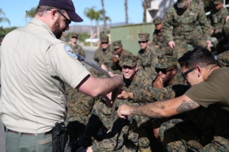 Sailors from 1st Medical Battalion, 1st Marine Logistics Group and various other units receive training from the Camp Pendleton Game Wardens Office about snakes and how to avoid harm from wildlife aboard Camp Pendleton, Calif., Nov. 19, 2015. Med. Bn. hosted a three-day training evolution with units across the western region to increase their readiness and proficiency in preventive medicine
