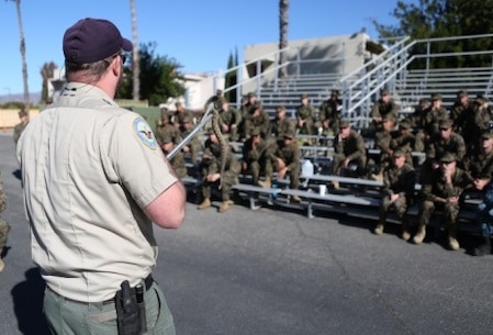 Sailors from 1st Medical Battalion, 1st Marine Logistics Group and various other units receive training from the Camp Pendleton Game Wardens Office about snakes and how to avoid harm from wildlife aboard Camp Pendleton, Calif., Nov. 19, 2015. Med. Bn. hosted a three-day training evolution with units across the western region to increase their readiness and proficiency in preventive medicine.