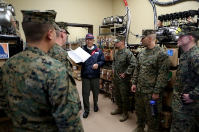 Sailors from 1st Medical Battalion, 1st Marine Logistics Group and various other units are given a guided tour through the 22 Area Mess Hall aboard Camp Pendleton, Calif., Nov. 19, 2015, as they are taught how to inspect a facility for health and cleanliness. Med. Bn. hosted a three-day training evolution with units across the western region to increase their readiness and proficiency in preventive medicine.