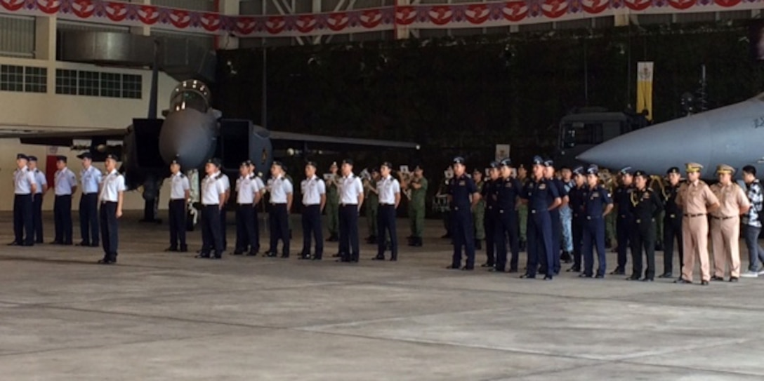Members from the U.S. Air Force, Royal Thai air force and the Republic of Singapore air force stand in formation during the opening ceremony of exercise Cope Tiger 2016, Korat RTAF Base, Thailand, Dec. 11, 2015. The purpose of the Pacific Air Forces-sponsored field training exercise is to reinforce current relationships by improving combined readiness and interoperability among military partners in the Indo-Asia-Pacific region. (Courtesy photo)