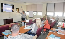 Sonya Brown, outreach program coordinator at Army Community Service, teaches the Care Team training at ACS Nov. 4.