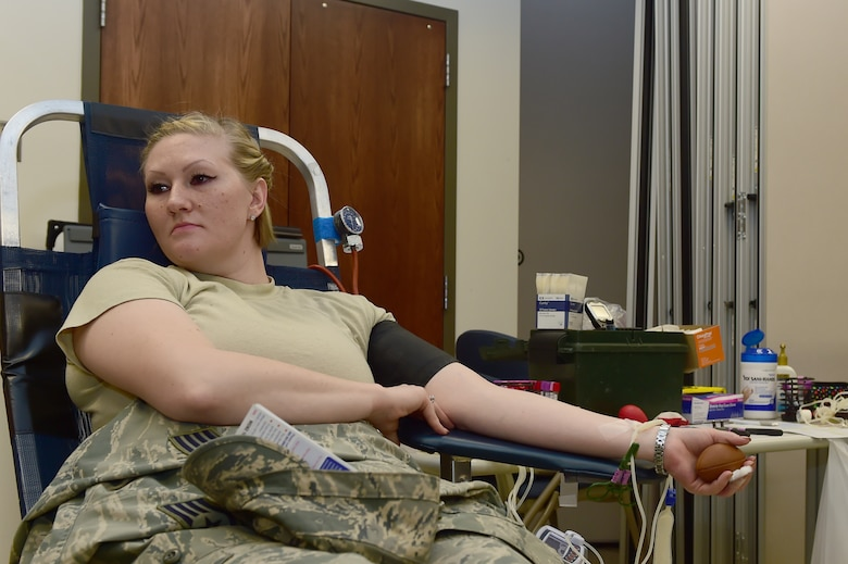 Staff Sgt. Charlotte Teitelbaum, 460th Medical Group bioenvironmental technician, donates blood during a blood drive hosted by Bonfils Blood Center at the Health and Wellness Center Dec. 22, 2015, on Buckley Air Force Base, Colo. The Bonfils Blood Center looks to build awareness and donations for those in need. (U.S. Air Force photo by Airman 1st Class Luke W. Nowakowski/Released)