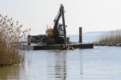 Dredging contractors work to remove roughly 23,300 cubic yards of material from Tylers Beach, a small harbor of refuge here, December 15, 2015. The $788,800 Sandy Recovery Improvement Act of 2013 funded project allows watermen and other boaters access to and from the small channel and harbor, which at times is impassable.