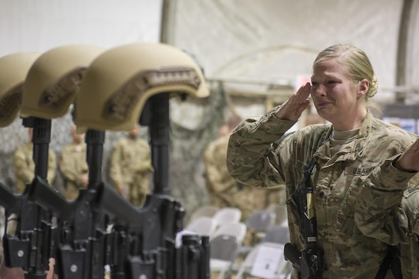 Service members from several units at Bagram Airfield, Afghanistan pay their respects during a fallen comrade ceremony held in honor of six Airmen Dec. 23, 2015.  The six Airmen lost their lives in an improvised explosive attack near Bagram Dec. 21, 2015. (U.S. Air Force photo by Tech. Sgt. Robert Cloys)