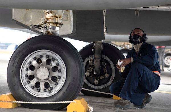 U.S. Air Force Airman 1st Class Adyel Quinones-Velez, a 18th Aircraft Maintenance Squadron crew chief, inspects the underside of an F-15 Eagle at Misawa Air Base, Japan, Dec. 15, 2015. Conducting an Aviation Training Relocation during winter provided Kadena AB, Japan, pilots and maintainers a change in environment. (U.S. Air Force photo/Airman 1st Class Jordyn Fetter)