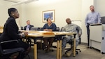 Logisticians from the U.S. Army Corps of Engineers and DLA HQs learn about and discuss DLA Troop Support's Construction and Equipment products and capabilities during a visit to the organization in Philadelphia Dec. 3, 2015.