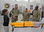 """The Defense Logistics Agency's regional commanders expressed their gratitude for the efforts of the DLA Troop Support workforce during a visit Dec. 2.   """"Working in [U.S. Central Command], where there's been active war for the last nearly 15 years, we live and die by these supply chains,"""" said Army Col. Derrin Williams, DLA Central commander.  Williams was joined by Army Col. Elizabeth Keough, DLA Europe and Africa commander, and Army Col. Richard Ellis, DLA Pacific commander. They are DLA's senior representatives in their respective regions.  While spending the week at DLA Headquarters in Fort Belvoir, Virginia, the three commanders traveled to Philadelphia to meet with representatives of DLA Troop Support's five supply chains and tour the flag room.  """"We mainly wanted to come say thanks,"""" Keough said. """"We couldn't function without the work that Troop Support does.""""  Williams's gratitude for the Clothing and Textiles supply chain was personal. He was shot by a sniper while deployed to Iraq. But thanks to body armor provided through C&T, the impact was minimized, he said.  """"I appreciate the time that goes into testing the [Enhanced Small Arms Protective Insert] plates,"""" Williams told Keith Ford, C&T deputy director. """"I appreciate you making sure it's right.""""  Keough specifically thanked Mary Martin, with the Medical supply chain's Plans and Integration division, by presenting her a commander's coin for her work in support of Operation United Assistance. OUA was the Defense Department mission in West Africa to help stop the spread of the deadly Ebola virus  Martin oversaw the transportation of personal protective equipment for personnel from DOD, U.S. Agency for International Development and the Public Health Service. Medical provided more than 1.4 million protective suits, in addition to surgical gloves and surgical masks in support of OUA, Martin said."""