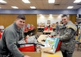Senior Airman Logan Stack, from Detachment 2, 56th Operations Group, and Staff Sgt. Tylor Strop, assigned to the 173rd Fighter Wing, pick up Christmas gifts from the Arthur Street Senior Center to deliver to Meals on Wheels clients Dec. 16, 2015, at Klamath Falls, Ore. The 173rd FW has partnered with the Arthur Street Senior Center for over 15 years to distribute the holiday gifts collected by the center. (U.S. Air National Guard photo/Staff Sgt. Penny Snoozy)