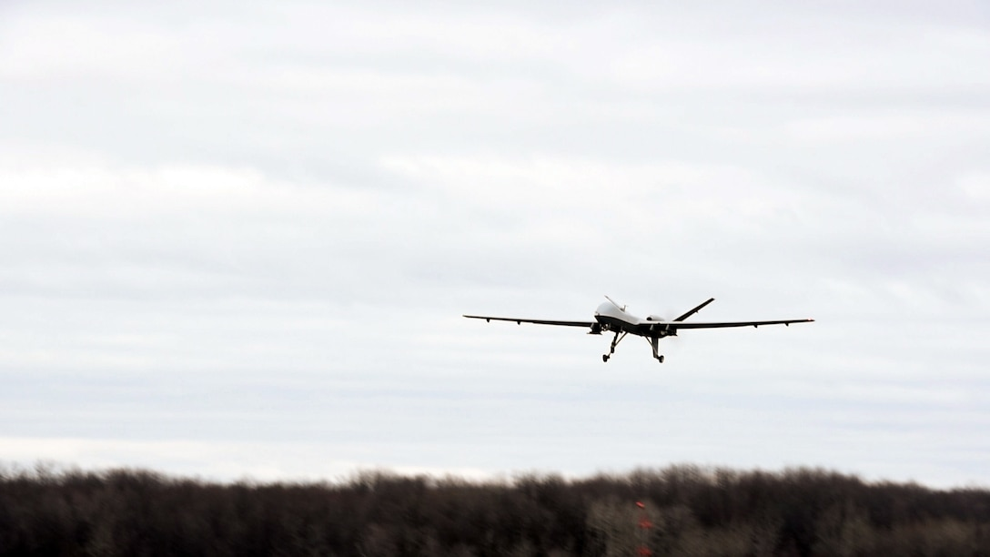 The New York Air National Guard's 174th Attack Wing conducted their first MQ-9 Reaper flying operation from Hancock Field Air National Guard Base and Syracuse Hancock International Airport, N.Y., Dec. 16, 2015. The 174th ATKW is the first Air Force organization in the U.S. to fly a remotely piloted aircraft in class C airspace, the common airspace around commercial airports. Prior to this week, all flight operations of the MQ-9 were conducted at Wheeler-Sack Army Airfield at Fort Drum, N.Y. (U.S. Air Force photo/Master Sgt. Eric Miller)