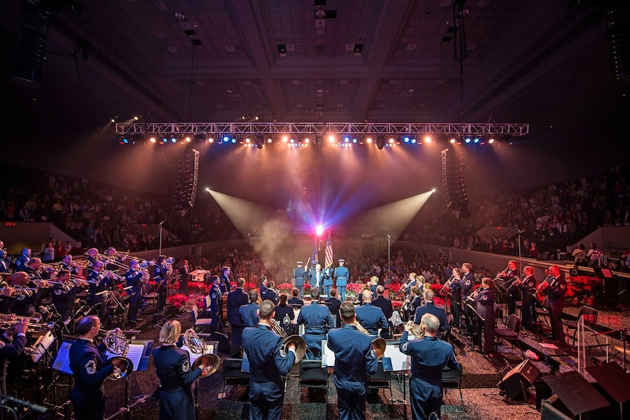 Col. Larry Lang conducts The U.S. Air Force Band along with the U.S. Air Force Honor Guard Color Team during the national anthem at the opening of the final holiday concert at DAR Constitution Hall in Washington D.C., Dec. 18, 2015. (U.S. Air Force photo/Senior Master Sgt. Kevin Burns)