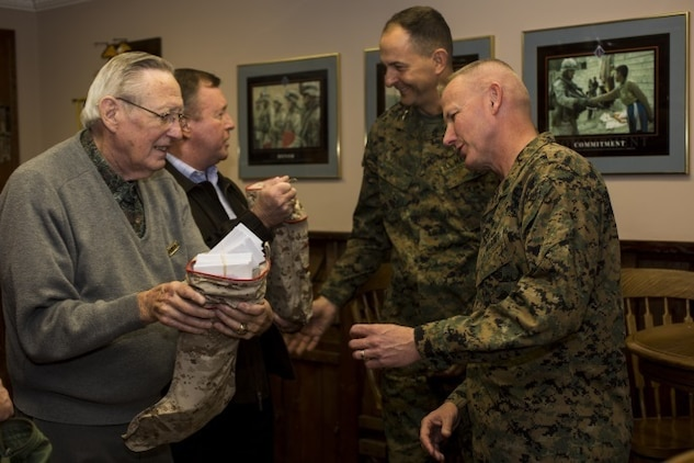 Maj. Gen. Daniel J. O'Donohue and Sgt. Maj. William T. Sowers stand for a quick photo opportunity following a ceremony with the San Diego Nice Guys charity group, Dec. 16, 2015. During the ceremony, the San Diego Nice Guys presented their annual contribution from the Marine Family Christmas Fund to assist local military families in their holiday grocery shopping. Since 1997, the MFCF has supported thousands of families, primarily those who have forward deployed Marines and sailors of the Blue Diamond division, with generous donations for the holiday season.