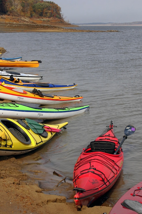 kayaks along shore