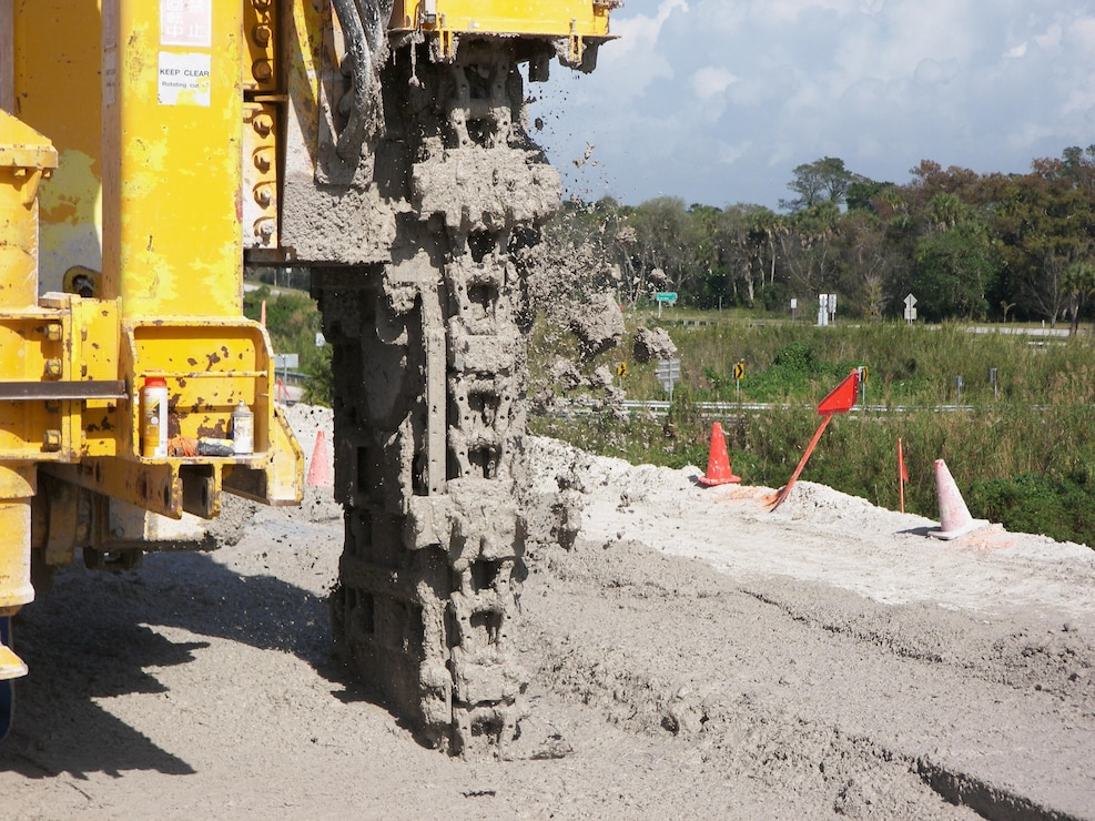 "The mud flies as machine functioning as a ""vertical chain saw"" mixes soil with slurry to form a partial cutoff wall in the Herbert Hoover Dike surround Lake Okeechobee in south Florida.  The work was part of a $220 million investment to reduce the risk of dike failure through installation of 21.4 miles of cutoff wall on the southeast side of the dike."