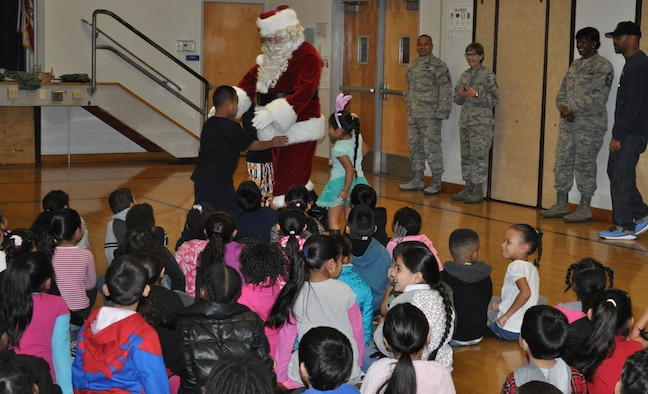 "Organized by the Airmen of the 349th Air Mobility Wing, supported by the 349th Medical and Maintenance Group ""elves,"" OTB visits local schools bearing gifts bags for the children in hopes of making their holidays a little more merry and bright!"
