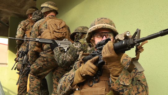 Marines prepare to clear a house alongside ROK Marines during the Korean Marine Exchange Program 16-3 at Rodriguez Live Fire Complex, South Korea, Dec. 22, 2015. KMEP 16-3 is one in a series of regularly-scheduled combined, small-unit, tactical training exercises. The relationship between ROK and U.S. Marine Corps forces encompasses the strategic, operational, and tactical levels of training. The goal of the KMEP is to enhance and improve interoperability of ROK an U.S. Marine Corps forces to build warfighting capabilities as partners. The Marines are from 1st Battalion, 2nd Marines Regiment, currently forward deployed in the Pacific as part of 4th Marine Regiment, 3rd Marine Division, III Marine Expeditionary Force. (U.S. Marine Corps Photo by Lance Cpl. Jorge A. Rosales/Released)