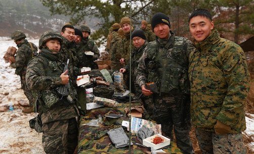 Marines share MRE's with Republic of Korea Marines at Rodriguez Live Fire Complex, South Korea, Dec. 21, 2015. Both Marines Corps will be training together and spending the holidays with each other. The Korean Marine Exchange Program is carried out in the spirit of the Republic of Korea-U.S. Mutual Defense Treaty signed between the two nations Oct. 1, 1953. The time spent together illustrates the enduring alliance and friendship between the ROK and U.S. The KMEP 16-3 focuses on the two countries' combined commitment to the defense of the ROK and our shared, faithful commitment to peace and security in the region. The Marines are from 1st Battalion, 2nd Marines Regiment, currently forward deployed in the Pacific as part of 4th Marine Regiment, 3rd Marine Division, III Marine Expeditionary Force. (U.S. Marine Corps Photo by Lance Cpl. Jorge A. Rosales/Released)
