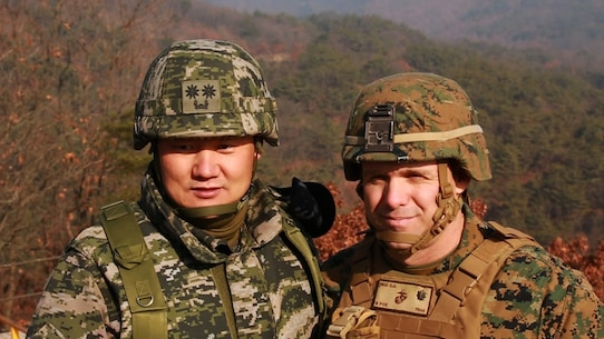 Republic of Korea Marine Lt. Col. Joung Young Oh and  Lt. Col. Eric A. Reid focus on  building lasting, bilateral relationships during the Korean Marine Exchange Program 16-3 at Rodriguez Live Fire Complex, South Korea, Dec. 22, 2015. KMEP 16-3 is one in a series of regularly-scheduled combined, small-unit, tactical training exercises between ROK and forward deployed U.S. Marines. The relationship between ROK and U.S. Marine Corps forces encompasses the strategic, operational, and tactical levels of training. The goal of the KMEP is to enhance and improve interoperability of ROK and U.S. Marine Corps forces at the level to build warfighting capabilities as partners. Lt. Col. Reid is the 1st Battalion, 2nd Marines regiment commander, currently forward deployed in the Pacific as part of 4th Marine Regiment, 3rd Marine Division, III Marine Expeditionary Force. (U.S. Marine Corps Photo by Lance Cpl. Jorge A. Rosales/Released)