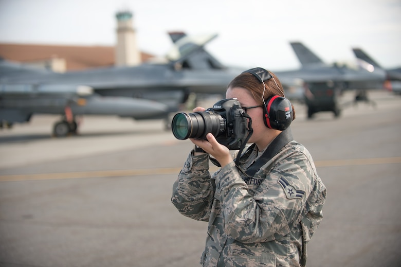 U.S. Air Force Airman 1st Class Cassandra Whitman, a 354th Fighter Wing public affairs photojournalist, takes photos Aug. 4, 2015, during RED FLAG-Alaska 15-3, at Eielson Air Force Base, Alaska. Whitman is approaching the one year mark in the Air Force and reflected on how her decision to join the military has positively affected her life. (U.S. Air Force photo by Staff Sgt. Shawn Nickel/Released)