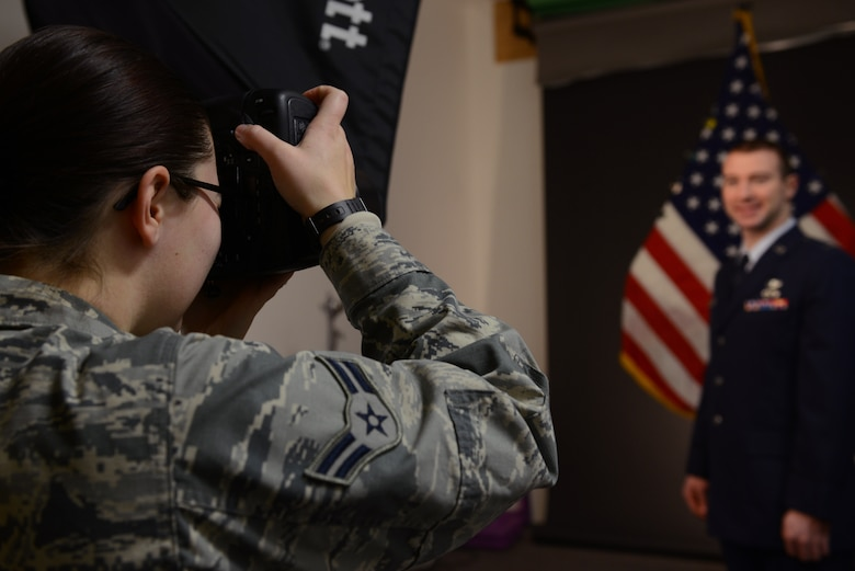 U.S. Air Force Airman 1st Class Cassandra Whitman, a 354th Fighter Wing public affairs photojournalist, takes a studio photo Dec. 22, 2015, at Eielson Air Force Base, Alaska. Whitman is approaching the one year mark in the Air Force and reflected on how her decision to join the military has positively affected her life. (U.S. Air Force photo by Senior Airman Ashley Nicole Taylor/Released)
