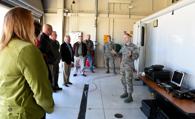 2nd Lt. Samuel Hardin, 188th Intelligence, Surveillance and Reconnaissance Group intelligence officer, describes the capabilities of the remote air, zonal operations, reach back-processing, assessment and dissemination (RAZORBack PAD) Dec. 18, 2015 to the Arvest Bank local senior management team and the regional board of directors at Ebbing Air National Guard Base, Fort Smith, Ark. The RAZORBack PAD can assist disaster workers on the ground with video from overhead aircraft to provide information on areas or people most in need during emergency response planning and operations. (U.S. Air National Guard photo by Senior Airman Cody Martin/Released)