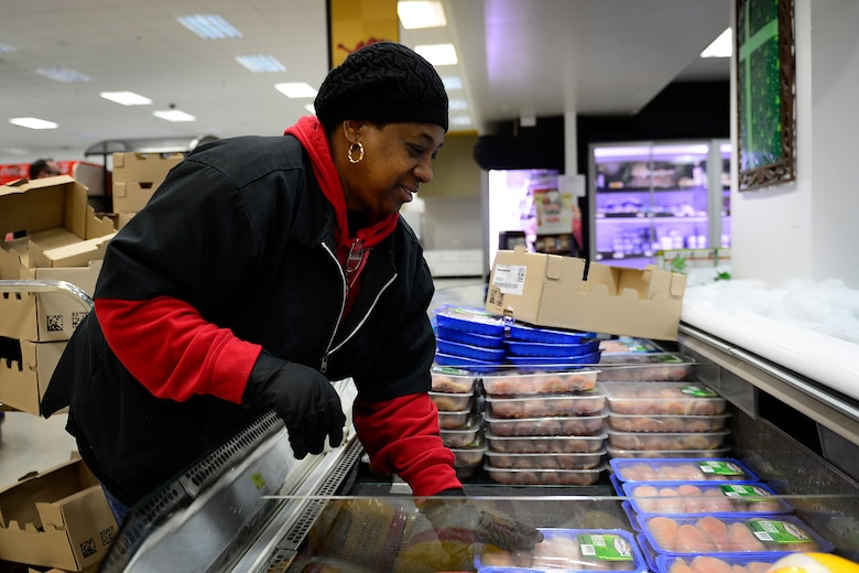 With almost 20 new employees, the staff helps to keep the products rotated and fresh for customers at the commissary at Royal Air Force Lakenheath, England, Dec. 7, 2015. Military personnel save an average of 30 percent or more shopping at the commissary. (U.S. Air Force photo by Airman 1st Class Erin R. Babis/Released)
