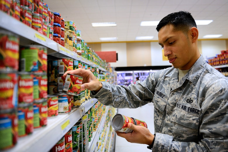 Military personnel save an average of 30 percent or more shopping at the commissary at Royal Air Force Lakenheath, England, Dec. 7, 2015. With almost 20 new employees, the new staff help to keep the products rotated and fresh for customers. (U.S. Air Force photo by Airman 1st Class Erin R. Babis/Released)
