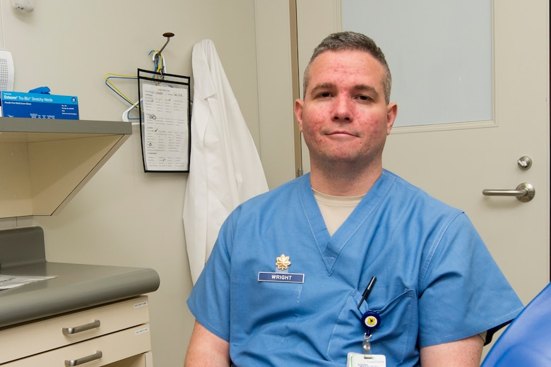U.S. Air Force Maj. William Wright, 18th Dental Squadron clinical flight commander, reflects on how he got to perform his dream job, Dec. 16, 2015, at Kadena Air Base, Japan. Wright decided to become a dentist while attending Kadena High School and began his career as an enlisted dental technician in the U.S. Air Force. (U.S. Air Force photo by Senior Airman Omari Bernard)