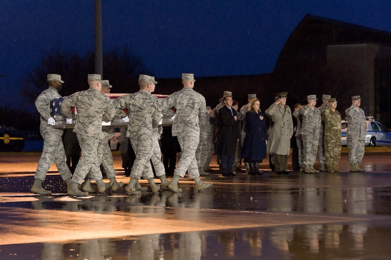 A U.S. Air Force carry team transfers the remains of Staff Sgt. Chester J. McBride, of Statesboro, Ga., during a dignified transfer Dec. 23, 2015, at New Castle Air National Guard Base, New Castle, Del. McBride was assigned to the Air Force Office of Special Investigations, Detachment 405, Maxwell Air Force Base, Ala. (U.S. Air Force photo/Roland Balik)