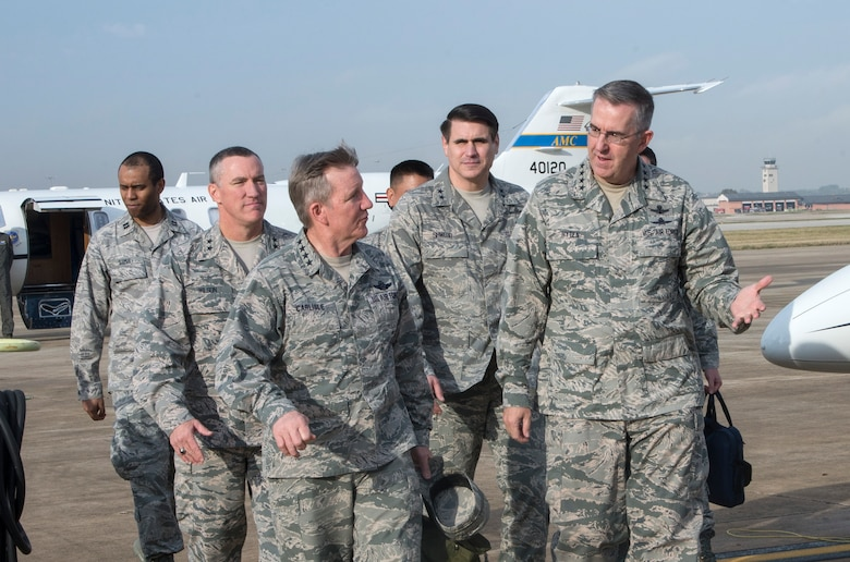 General Hawk Carlisle, Air Combat Command commander, and General John E. Hyten, Air Force Space Command commander, are escorted by Maj. Gen. Ed Wilson, 24th Air Force commander, and Maj. Gen. BJ Shwedo, 25th Air Force commander during a visit to Joint Base San Antonio – Lackland Dec 21. The MAJCOM commanders received briefings from their respective Numbered Air Force and discussed a series of cyber and global ISR initiatives. (U.S. Air Force photo by Johnny Saldivar)