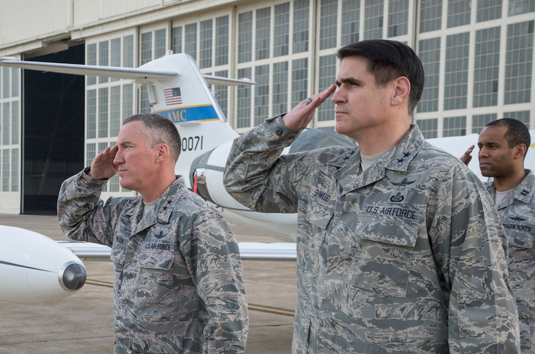 Maj. Gen. Ed Wilson, 24th Air Force commander and Maj. Gen. BJ Shwedo, 25th Air Force commander salute the arrival of General John E. Hyten, Air Force Space Command commander at Joint Base San Antonio – Lackland, Texas Dec 21. (U.S. Air Force photo by Johnny Saldivar)