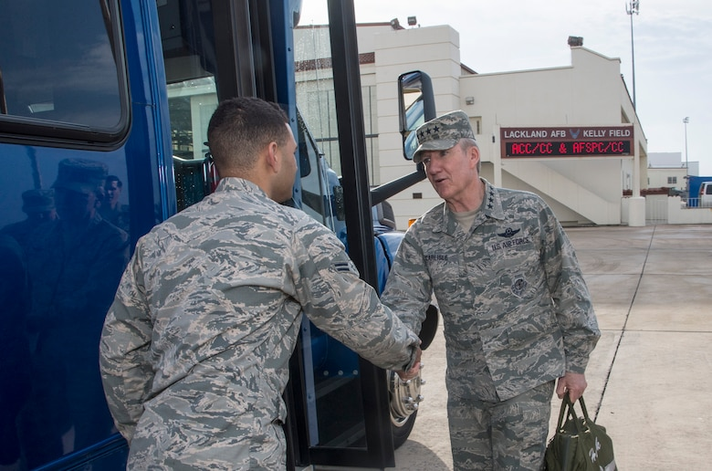 General Hawk Carlisle, Air Combat Command commander greets Airman 1st Class Tariq Williams, 502nd Transportation Specialist during a visit to Joint Base San Antonio-Lackland 21 Dec. (U.S. Air Force photo by Johnny Saldivar)