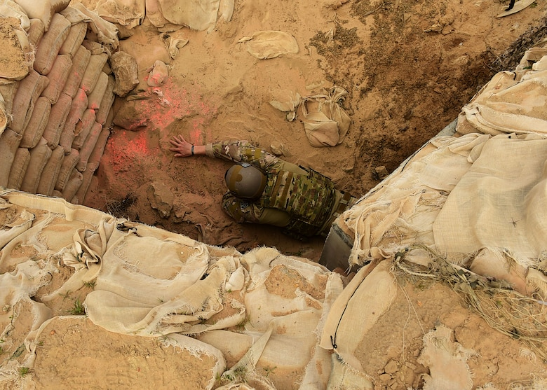 Staff Sgt. Andrew Croop, a 386th Air Expeditionary Wing explosive ordnance disposal technician, conducts a finger sweep for ordnances during a joint EOD training exercise at an undisclosed location in Southwest Asia, Dec. 15, 2015. The 386th EOD flight hosted Marine and Army EOD techs for the exercise as a way to learn from each other's experiences and the different service's methods. (U.S. Air Force photo by Staff Sgt. Jerilyn Quintanilla)