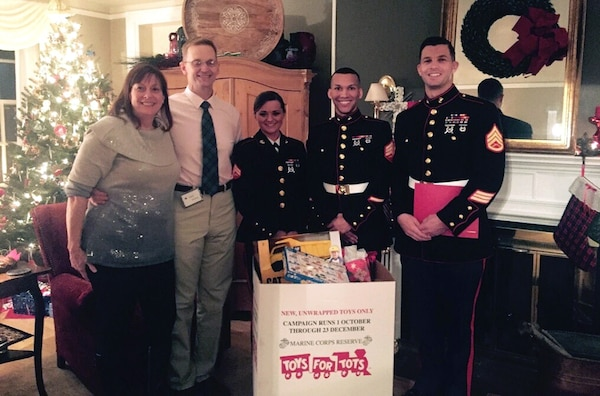 Toys for Tots donations are collected by, from left to right, Laura McLeod, Air Force Brig. Gen. Mark McLeod, Marine Cpl. Chelsea Propes, Marine Sgt. Robert Bradley and Marine Staff Sgt. Andrew Eichelberger. Defense Logistics Agency Energy employees contributed more than 150 toys during the DLA Energy commander's holiday reception at Fort Belvoir, Virginia, Dec. 19. Photo by Army Capt. Keith De Silva