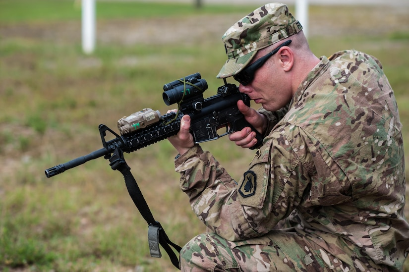 Capt. Kirk Freeman with the 98th Training Division and a member of the U.S. Army Reserve Marksmanship Team checks the zero of his Close Combat Optics during the first day of the U.S. Army Forces Command Weapons Marksmanship Competition Sept. 21, 2015, at Fort Bragg, N.C. The three-day FORSCOM competition features 27 marksmen from the U.S. Army, U.S. Army Reserve, and the National Guard in events for the M9 pistol, the M4A1 rifle, and the M249 SAW, or Squad Automatic Weapon, to recognize Soldiers who are beyond expert marksmen. The multi-tiered events challenge the competitors' ability to accurately and quickly engage targets in a variety of conditions and environments. (U.S. Army photo by Timothy L. Hale/Released)