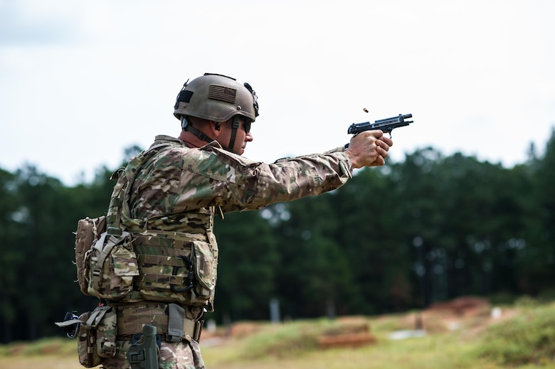 Master Sgt. Russell Moore with the 416th Theater Engineer Command and a member of the U.S. Army Reserve Marksmanship Team qualifies with his M9 pistol during the first day of the U.S. Army Forces Command Weapons Marksmanship Competition Sept. 21, 2015, at Fort Bragg, N.C. The three-day FORSCOM competition features 27 marksmen from the U.S. Army, U.S. Army Reserve, and the National Guard in events for the M9 pistol, the M4A1 rifle, and the M249 SAW, or Squad Automatic Weapon, to recognize Soldiers who are beyond expert marksmen. The multi-tiered events challenge the competitors' ability to accurately and quickly engage targets in a variety of conditions and environments. (U.S. Army photo by Timothy L. Hale/Released)