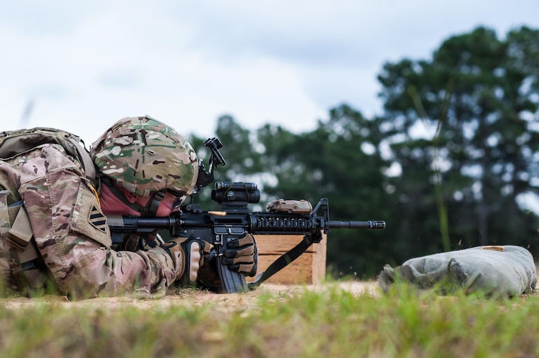 Capt. Kirk Freeman with the 98th Training Division and a member of the U.S. Army Reserve Marksmanship Team qualifies with his M4 rifle during the first day of the U.S. Army Forces Command Weapons Marksmanship Competition Sept. 21, 2015, at Fort Bragg, N.C. The three-day FORSCOM competition features 27 marksmen from the U.S. Army, U.S. Army Reserve, and the National Guard in events for the M9 pistol, the M4A1 rifle, and the M249 SAW, or Squad Automatic Weapon, to recognize Soldiers who are beyond expert marksmen. The multi-tiered events challenge the competitors' ability to accurately and quickly engage targets in a variety of conditions and environments. (U.S. Army photo by Timothy L. Hale/Released)