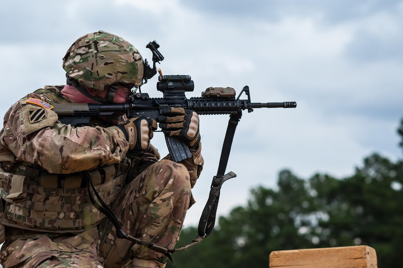 Capt. Kirk Freeman with the 98th Training Division and a member of the U.S. Army Reserve Marksmanship Team, qualifies with his M4 rifle during the first day of the U.S. Army Forces Command Weapons Marksmanship Competition Sept. 21, 2015, at Fort Bragg, N.C. The three-day FORSCOM competition features 27 marksmen from the U.S. Army, U.S. Army Reserve, and the National Guard in events for the M9 pistol, the M4A1 rifle, and the M249 SAW, or Squad Automatic Weapon, to recognize Soldiers who are beyond expert marksmen. The multi-tiered events challenge the competitors' ability to accurately and quickly engage targets in a variety of conditions and environments. (U.S. Army photo by Timothy L. Hale/Released)