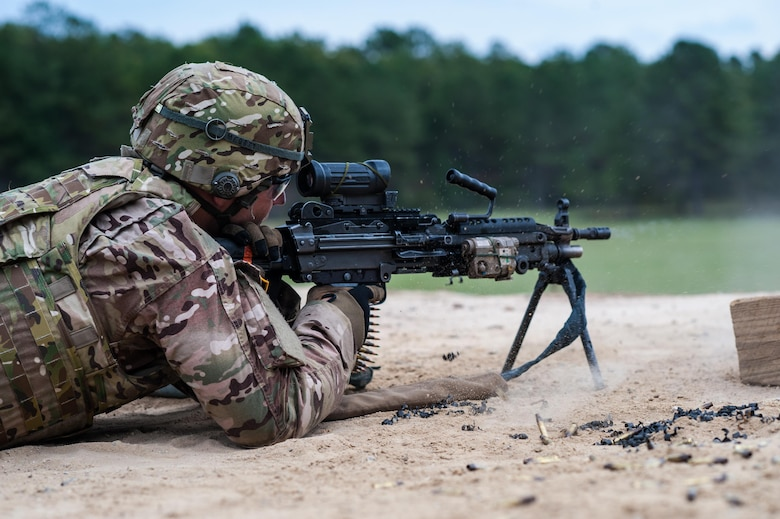 Sgt. Ben Mercer with the 416th Theater Engineer Command and a member of the U.S. Army Reserve Marksmanship team qualifies with his M249 Squad Automatic Weapon, or SAW, during the first day of the U.S. Army Forces Command Weapons Marksmanship Competition Sept. 21, 2015, at Fort Bragg, N.C. The three-day FORSCOM competition features 27 marksmen from the U.S. Army, U.S. Army Reserve, and the National Guard in events for the M9 pistol, the M4A1 rifle, and the M249, to recognize Soldiers who are beyond expert marksmen. The multi-tiered events challenge the competitors' ability to accurately and quickly engage targets in a variety of conditions and environments. (U.S. Army photo by Timothy L. Hale/Released)